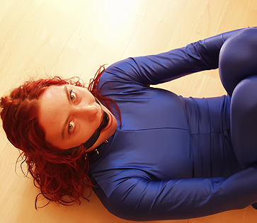 Girls in bondage wearing spandex are mistaken